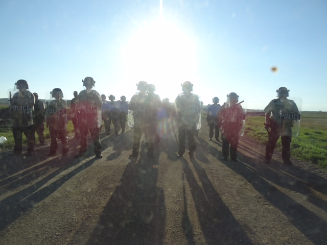 protesters and police at Standing Rock Sioux Reservation