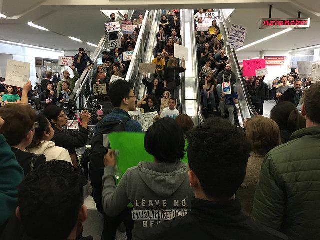 protesters against the Muslim ban at San Francisco airport jam the escalators
