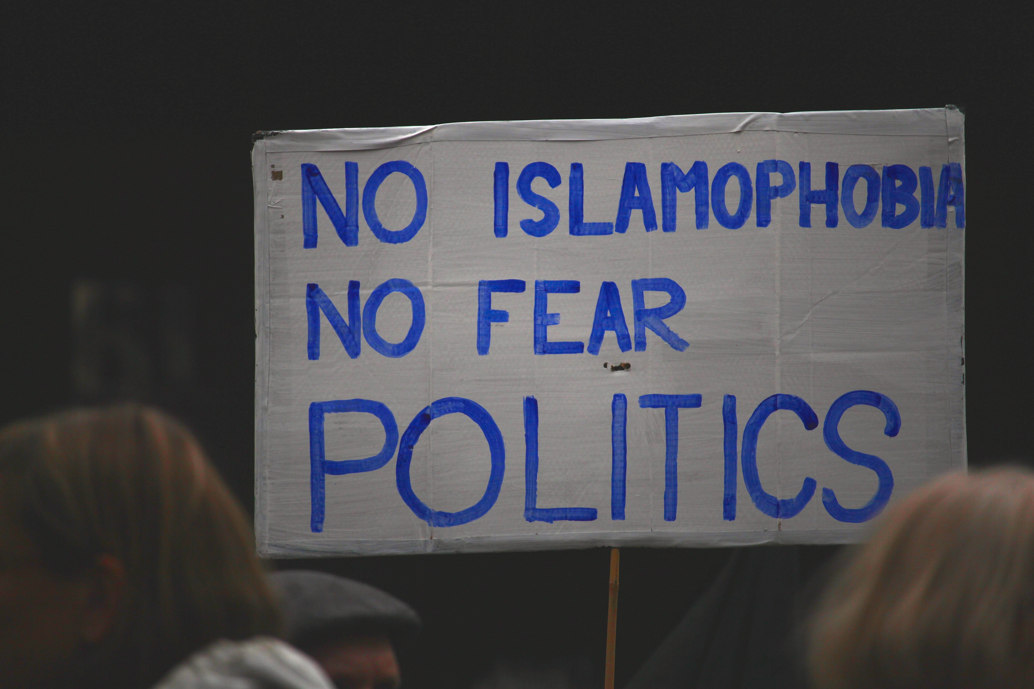 hand painted sign says no islamophobia no fear politics