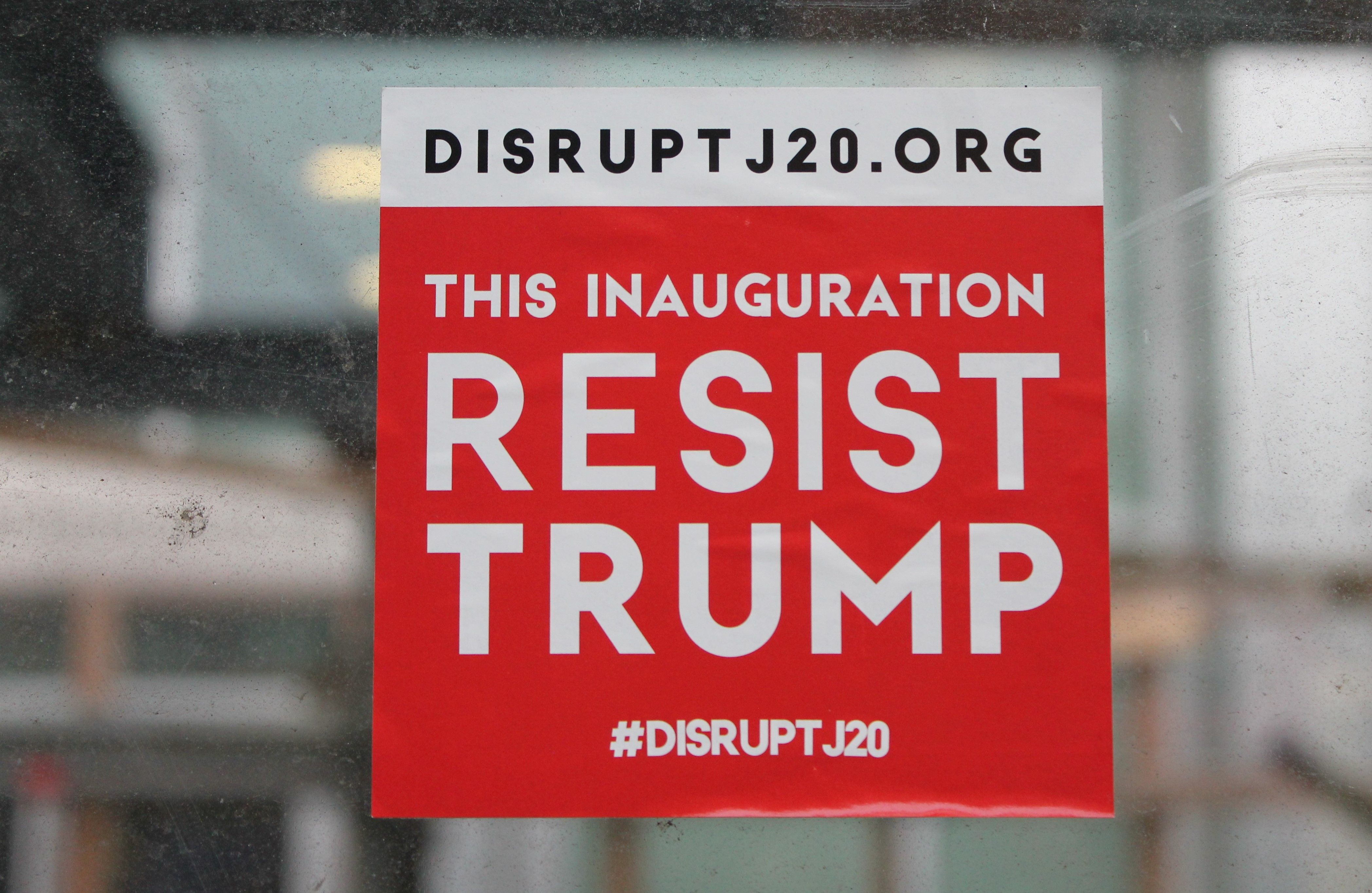 """sticker at construction site in DC says """"resist Trump"""" with Disrupt J20 website"""