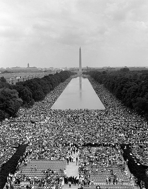 view of the 1963 March of Washington, crowds fill the space from the LIncoln memorial to Washington monument